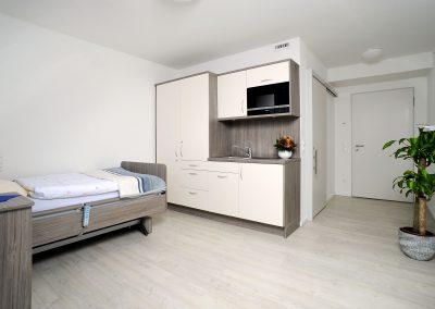Komfort-Zimmer mit Küchenzeile